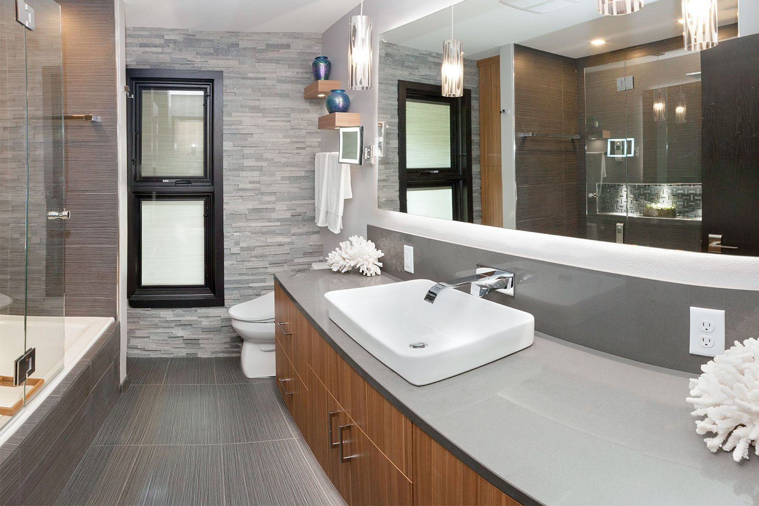 Bathroom sink and grey stone wall