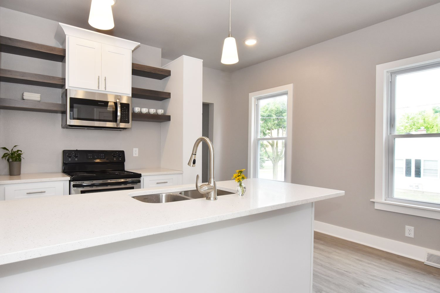 Wauwatosa White kitchen island with open shelving and quartz counters