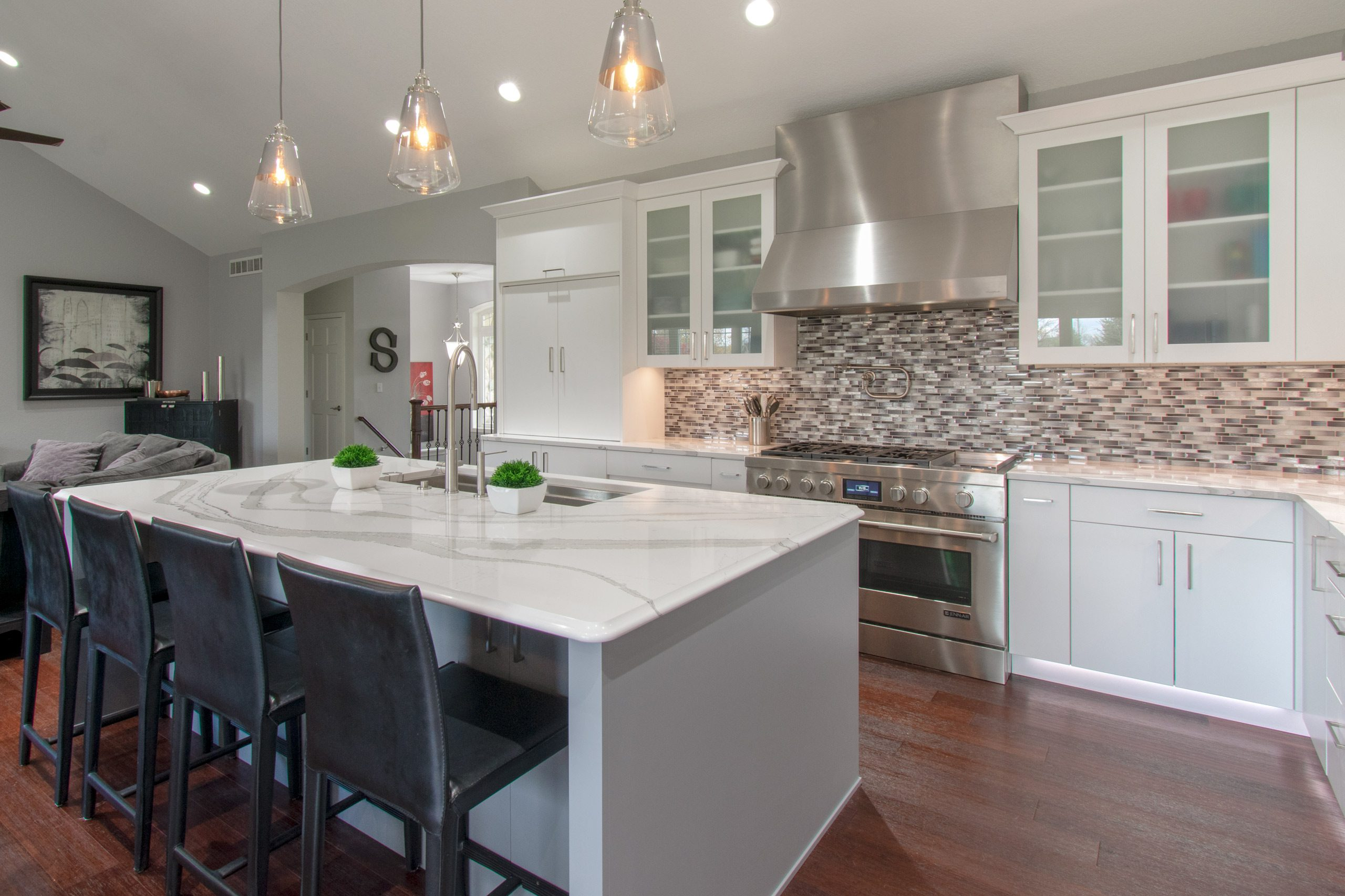 Lake Country contemporary kitchen with island, Cambria quartz counter, mosaic backsplash