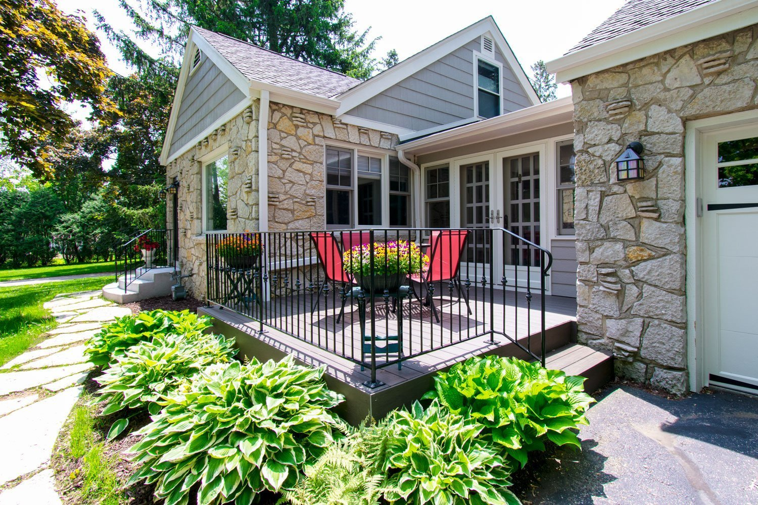 Delafield lannon stone cottage deck exterior renovation