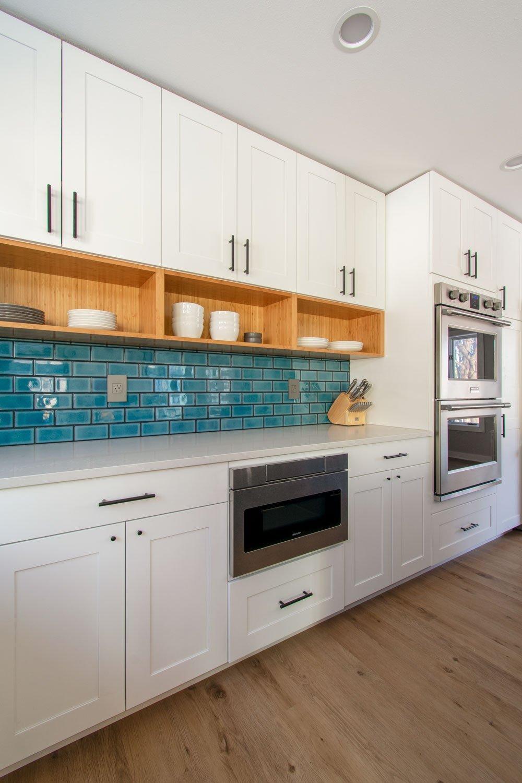 Delafield kitchen blue subway tile backsplash