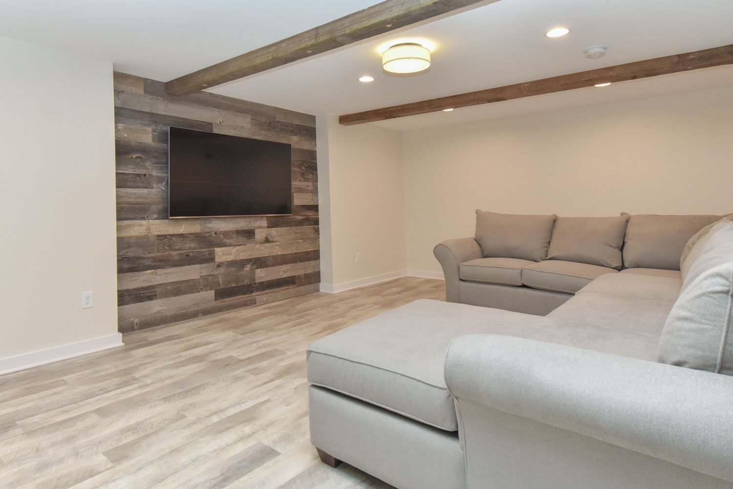 Basement bar remodel with barn wood wall