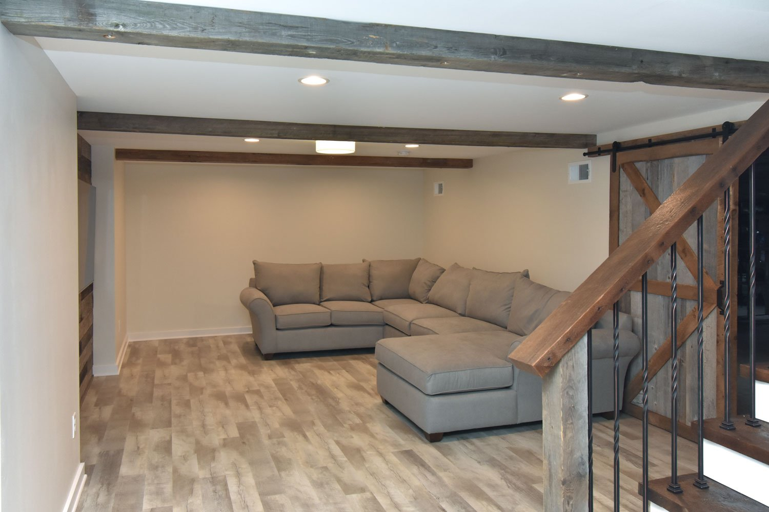 Basement bar remodel with sliding barn door