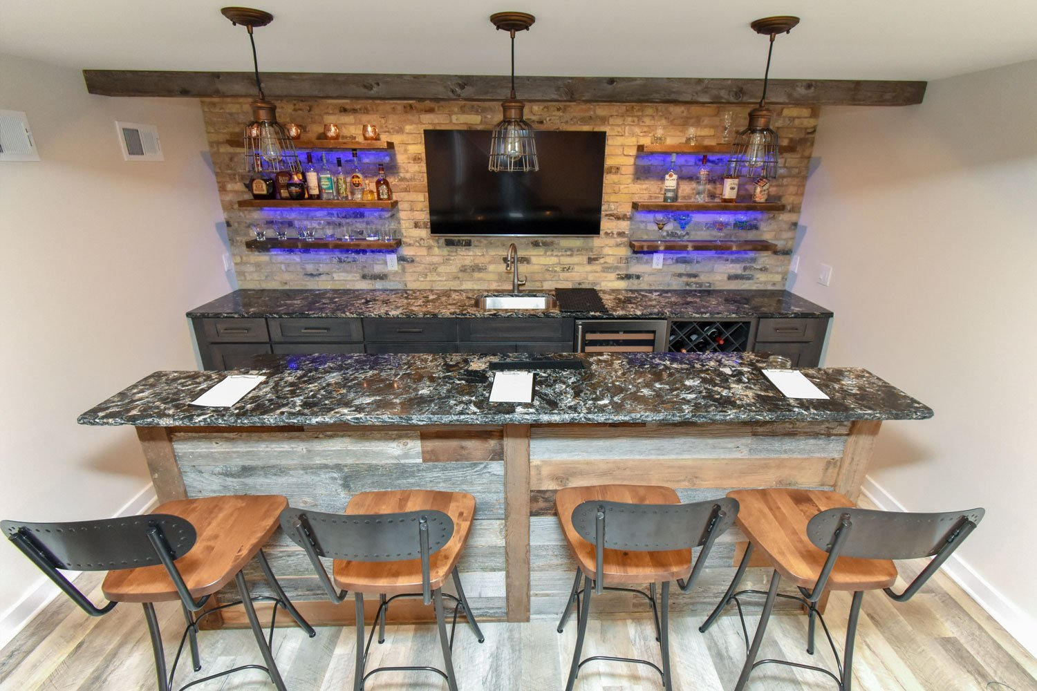 Basement bar remodel with LED under shelf lighting