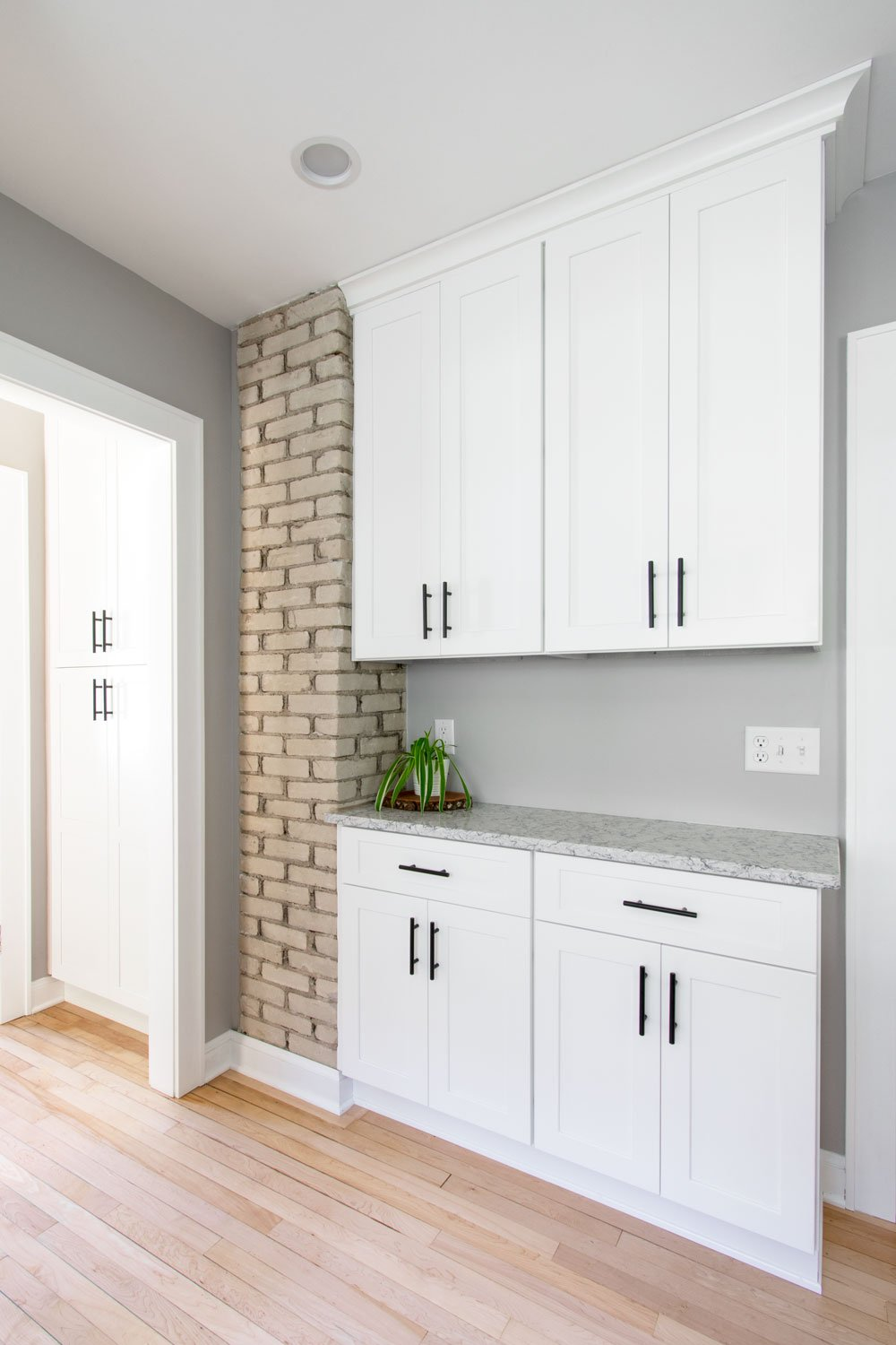 Brick wall and white cabinets