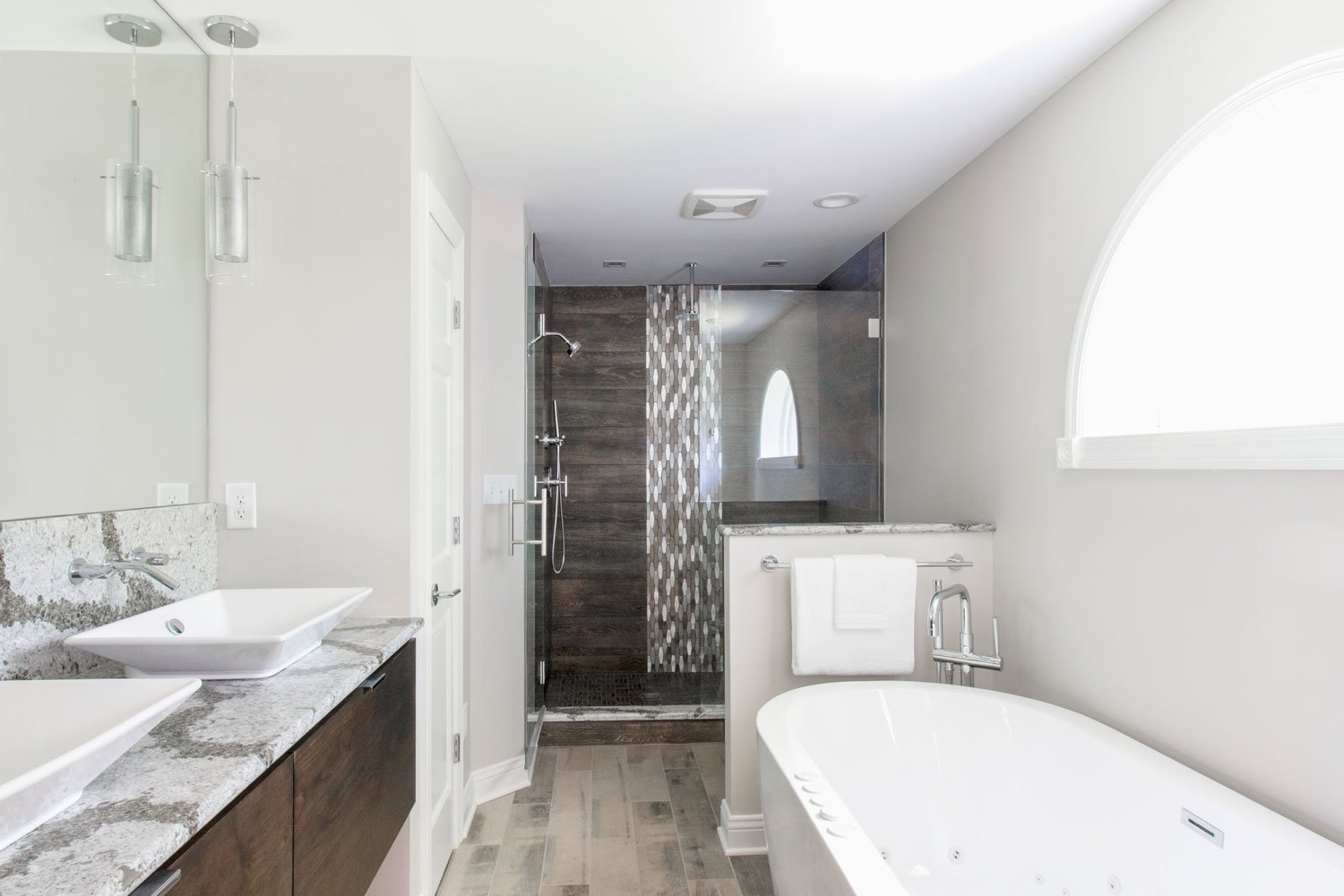 Spa-like master bathroom with walk in glass shower