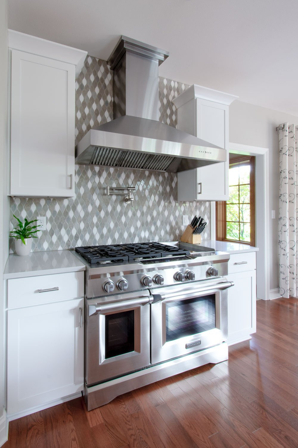 Pewaukee kitchen remodel with white shaker cabinets and pot filler faucet