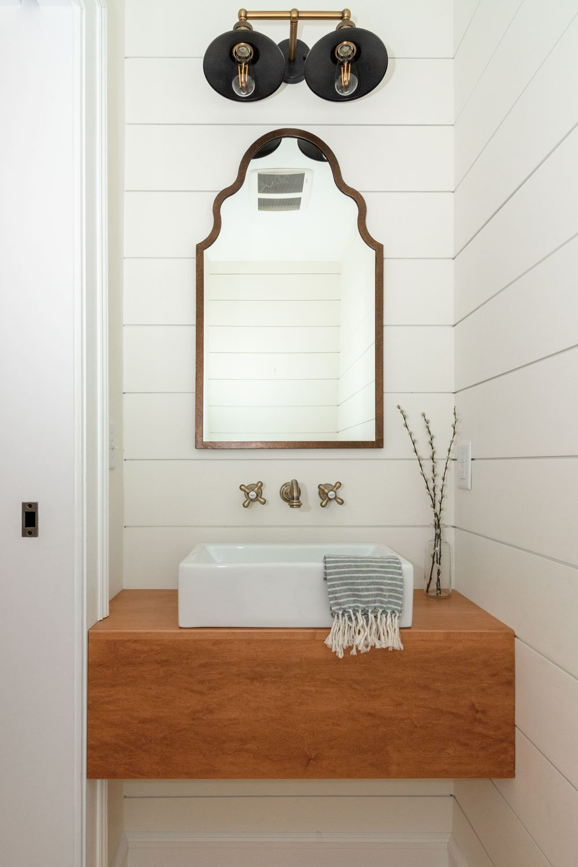 Powder bath with floating wood vanity and shiplap walls