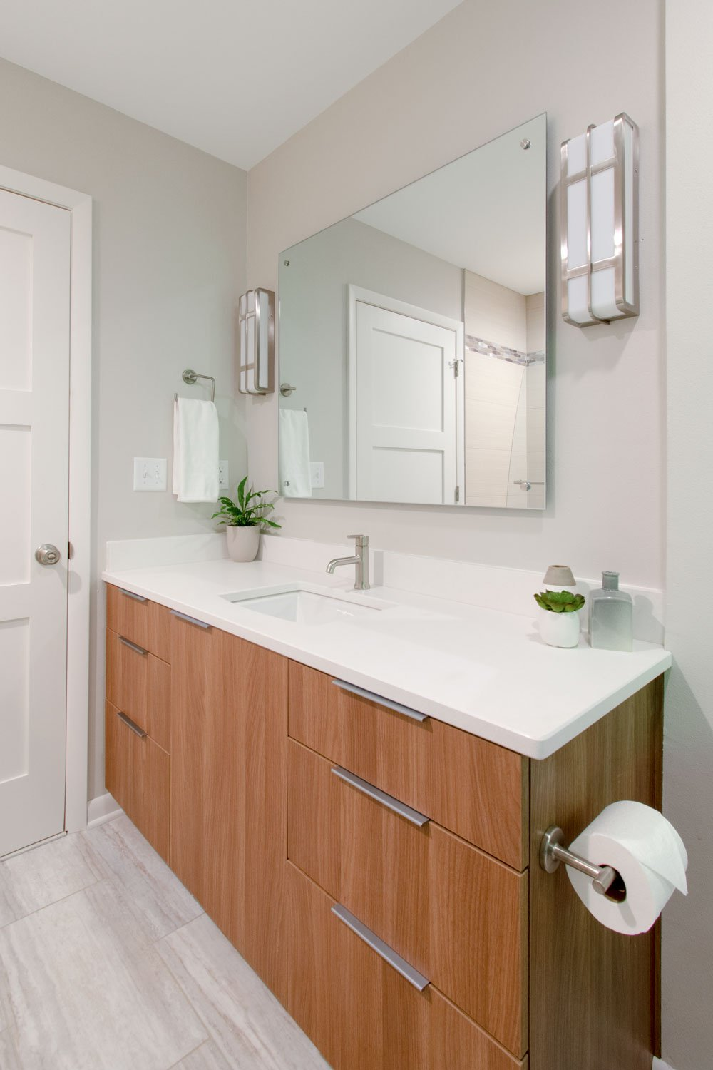sleek wood bathroom vanity with quartz counters