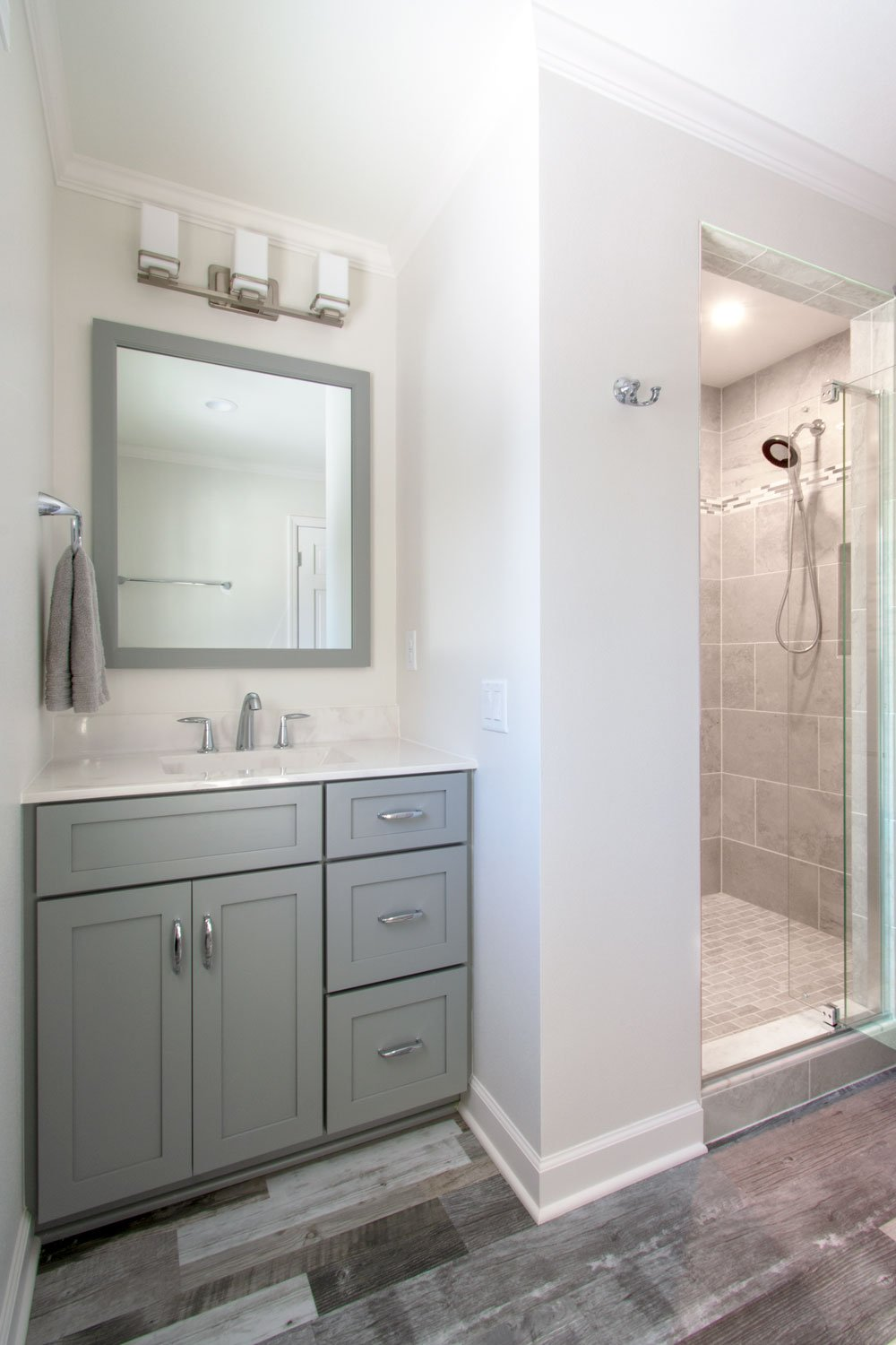 gray vanity and walk in shower