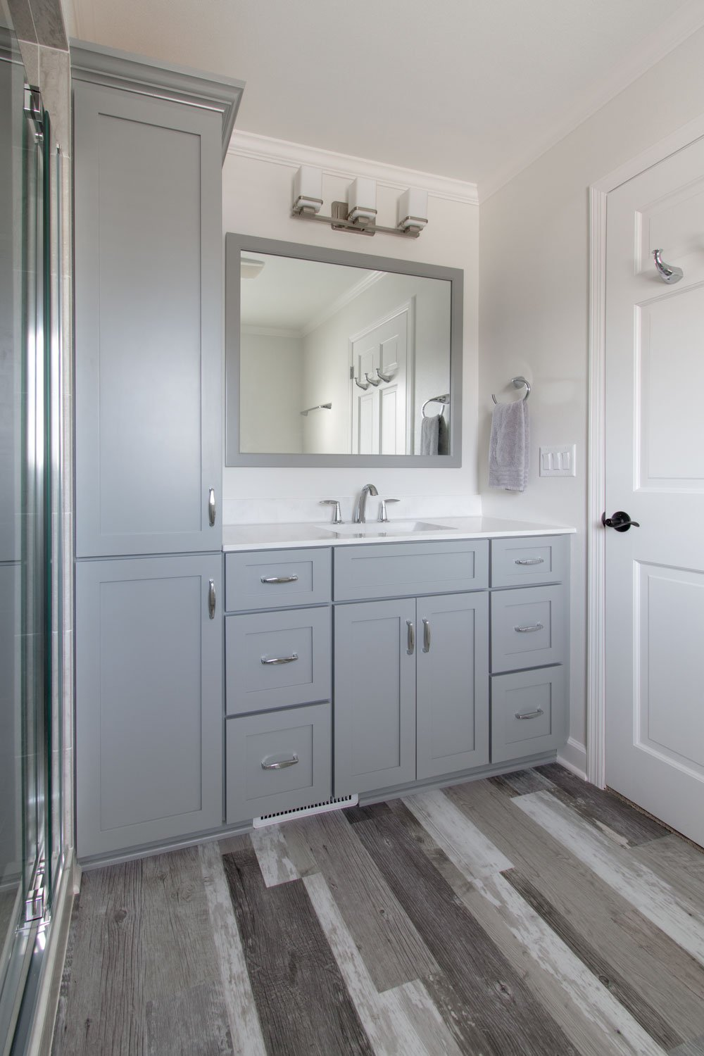gray cabinetry and vinyl plank flooring