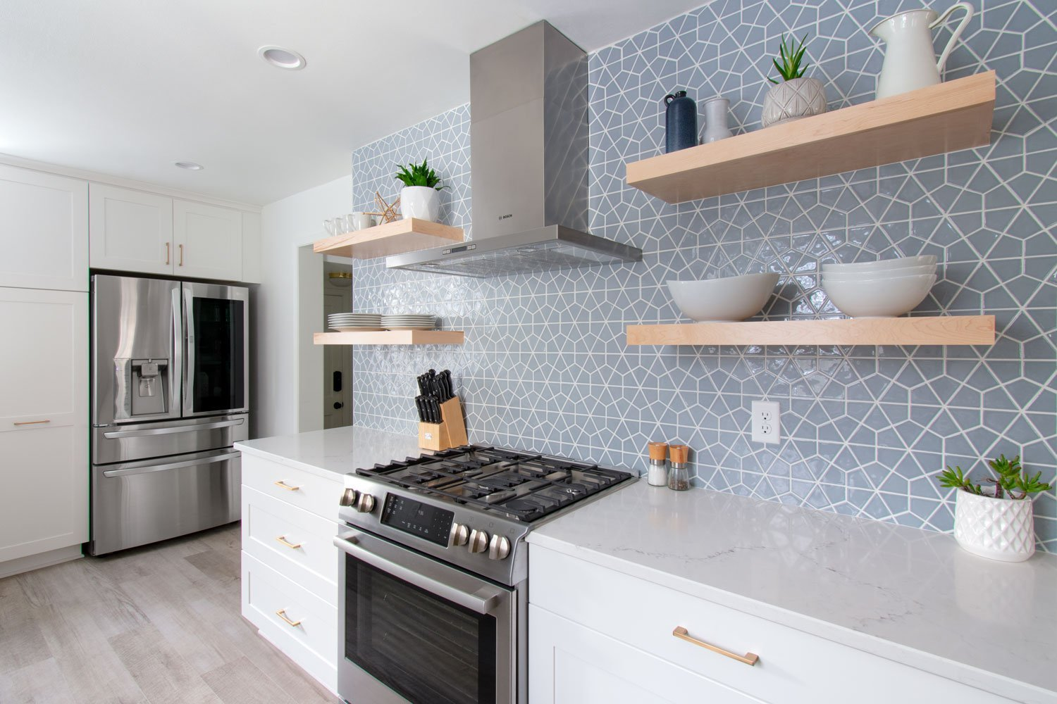 Open shelving with blue hexagon tile wall