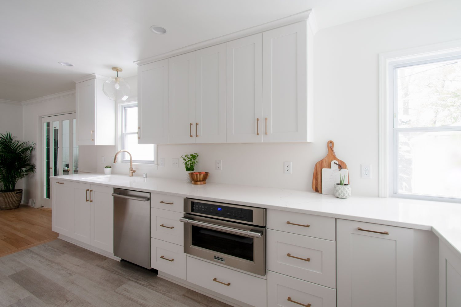 White shaker kitchen cabinetry with bronze hardware