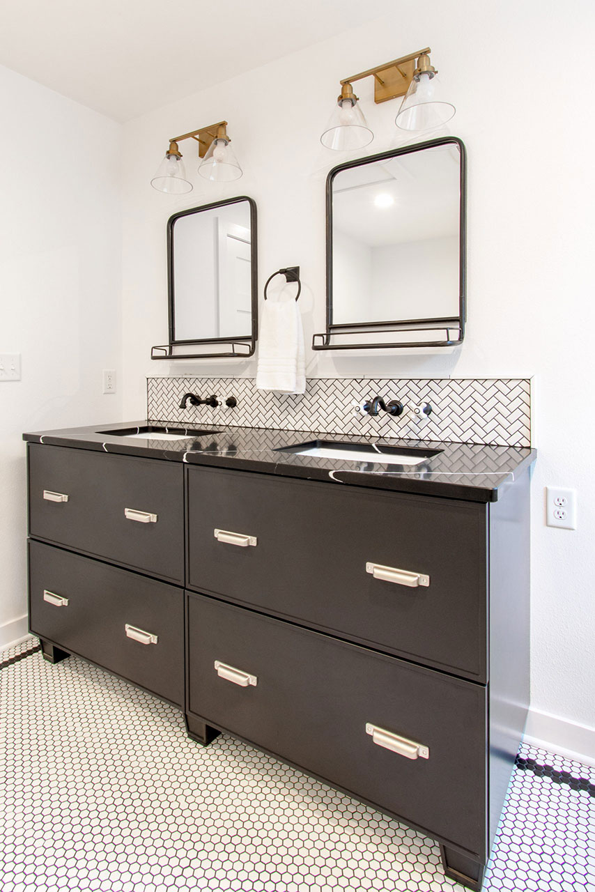 Delafield classic black and white master bathroom with black vanity, herringbone backsplash and hexagon tile floor