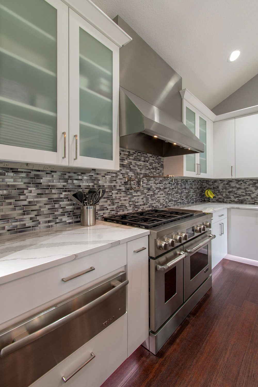 Lake Country contemporary kitchen with island, Cambria quartz counter, mosaic backsplash