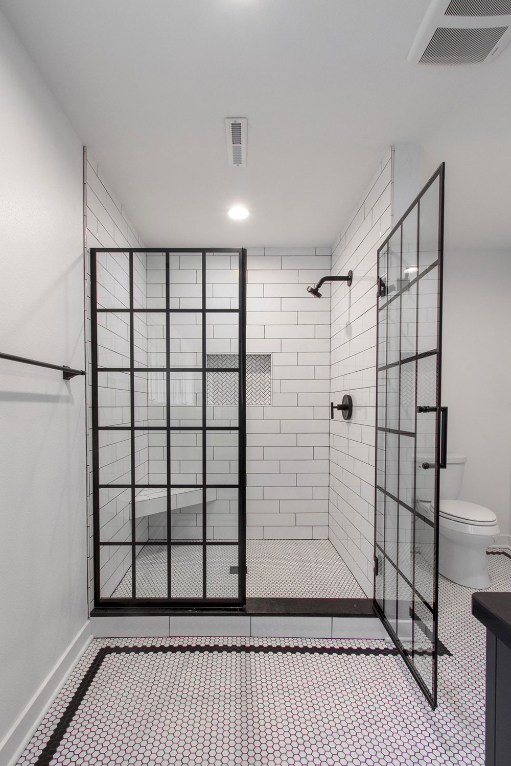 Delafield black and white bathroom shower
